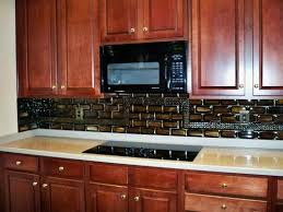 for this commissioned kitchen backsplash we created fused glass stacked tiles with layers of iridized gold black streaky woodlands