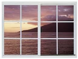 a window overlooking the beach