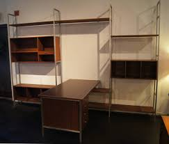 aluminum walnut modular wall shelving system with desk by paul mccobb for h sacks for