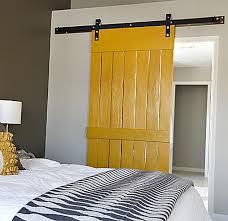 bedroom rustic barn door headboard brown stained log wood bed combined grain frame wall mirror