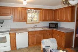 fabulous white color small home. Fabulous White Color Resurfacing Kitchen Cabinets And Combine With Curved Shape Island Also Black Marble Counte Home Small