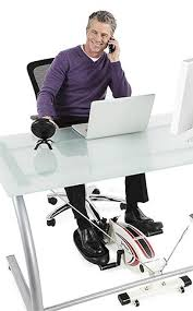 office exercise equipment. Beautiful Equipment Office Worker Using An Under Desk Elliptical On Exercise Equipment E