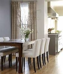 chic chairs in lieu of ordinary dining room table chairs adds a bit of modern style to the dining room