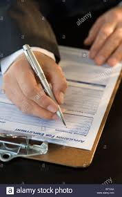 man filling out employment application stock photo royalty man filling out employment application