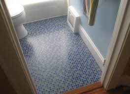 blue bathroom floor tiles. Blue Bathroom Mosaic Floor Tile With Multi Color Striped Hanging Towel And Small Toilet Also Sky Painted Wall Tiles