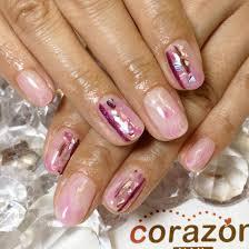 シェルストーン貝殻 貝殻のパーツを大きめに縦に並べた ピンクと紫の