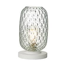 textured clear glass table lamp with white base
