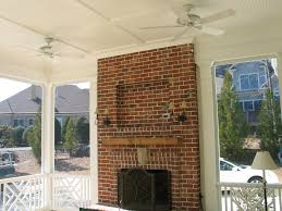 brick outdoor fireplace on screened porch