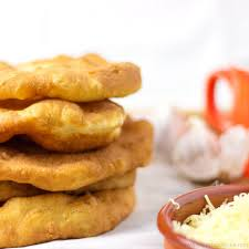 langos is a hungarian deep fried flat bread made of yeast flour water