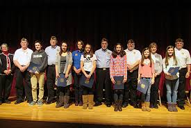 this year s winners of the patriot pen essay contest from koda and  students standing on stage veterans