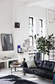 airy living room decoratin ideas with black leather sofa black leather sofa