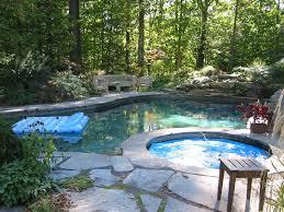 flagstone patio surrounding pool and hot tub
