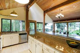 Vaulted Ceiling Kitchen White Kitchen Room With Steel Appliances And High Vaulted Ceiling