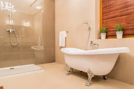 claw foot bathrub with silver fixtures in master suite