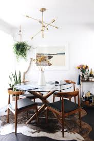 rug under round kitchen table. Cowhide Rug Under Round Dining Table \u2013 Beautiful Shapes In The Furniture Here. I\u2026 Kitchen