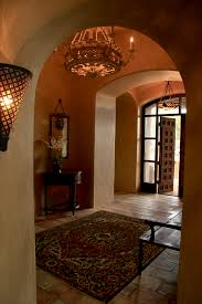 an antique entry door and reclaimed floor pavers recreate the ol on stunning modern foyer chandeliers