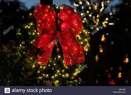 Lighted Holiday Bow A Lighted Evergreen Christmas Wreath With A Large Red Bow