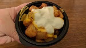 taco bell cheesy fiesta potatoes. Interesting Potatoes TasteTime Review Taco Bell Cheesy Fiesta Potatoes On A