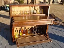 Repurposed-piano-full-bar-and-cabinet