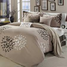 modern bedroom with fashionable bedding sets creamy comfortable blanket with leaf motif comfortable blanket