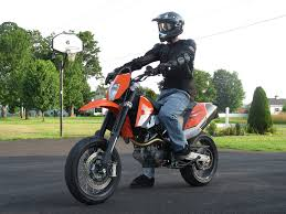 me in full gear with my 690 smc including a wheelie