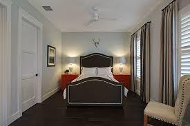 miami dark hardwood floors bedroom transitional with black