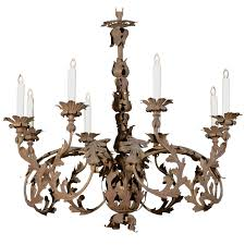 italian 1890s wrought iron eight light chandelier with scrolling acanthus leaves