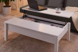 a white trulstorp coffee table with the top lifted up