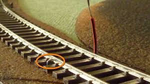 ering dcc rail droppers rudysmodelrailway strip the wire over 10 mm and tin it 2 bend the tinned wire into an l shape over 2 mm image 1 3 push the wire down and manoeuvre