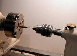 drill press metal lathe. the drill chuck mounts in tail stock and bits are attached using a key, just like press. press metal lathe