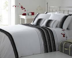 comfortable black and white striped bedding with white table