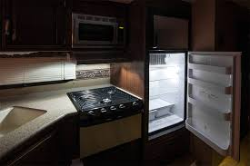 6 rectangular led dome light fixture with switch shown installed over rv stove