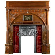 carved oak art nouveau antique fireplace mantel and integral cast iron insert at 1stdibs
