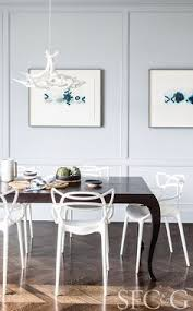 in the breakfast nook a roll hill chandelier and kartell chairs are from design