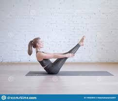 Light Pilates Yoga Studio Beautiful Girl In Grey Sports Suit Doing Workout On Math