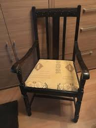 attractive dark wooden chair carved detail to top of chair good clean condition