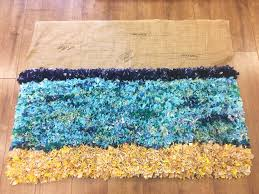 large blue yellow partially made rag rug