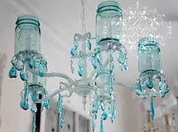 ball jar lighting. how amazing is this blue ball jar chandelier lighting
