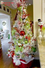 I've always wanted a white tree! whimsical christmas tree - LOVE the colors  and the topper too!