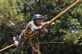 u s department of defense photo essay a an special operations team member pulls himself along a rope during the fuerzas c do 2015