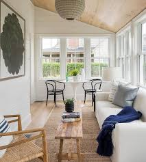 tongue and groove sunroom with sloped plank ceiling