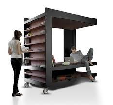A bookshelf that doubles up as a portable workspace. Great idea but I have  a feeling those books will come tumbling down if you tried to move the  furniture.