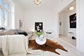 cowhide rug living room 35 light and stylish scandinavian living room designs cowhide rugs interior design