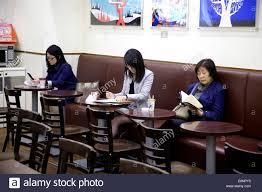 female manager young businesswoman anese business woman working in bar old lady reading
