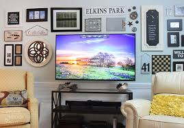 wall mounted tv hidden wires tutorial installing a wall mount flat screen tv hiding cords prettyhandygirl