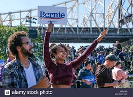 October 19, 2019, Queens, New York, United States: Bernie Sanders  supporters show their enthusiasm as he