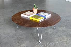 thin wooden top round cocktail table with hairpin legs for small living room spaces with concrete floor tiles ideas