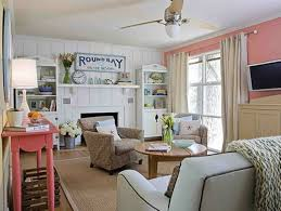 Styling A Round Coffee Table Beach House Style With Coral And White Walls And Slipcovered Arm
