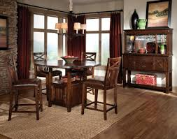 square honey rug traditional style under round wooden dining table set with shelves and brown leather seat