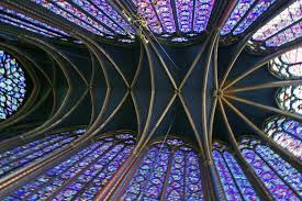a big pane in the glass the vaulted ceiling of st chapelle cathedral is over 50 feet high and is the focal point of 15 huge stained glass windows